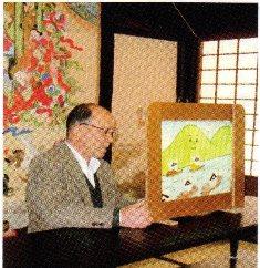 紙芝居「草倉銅山物語」の読み聞かせを行っている阿賀町鹿瀬の伊藤和夫さん。